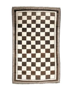 An unusually large Mid 20th c. Persian Gabbeh carpet in a black and white check design measuring 6 ft 7 in x 10 ft 4 in