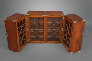 POLISHED TEAK FOLDING CAMPAIGN BOOKCASE, ENGLAND, C. 1810-20